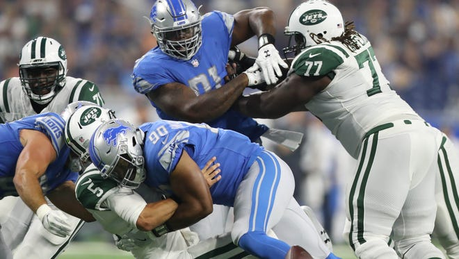 Lions' Cornelius Washington forces a fumble by the Jets' Christian Hackenberg in the first quarter Saturday, Aug. 19, 2017 at Ford Field.