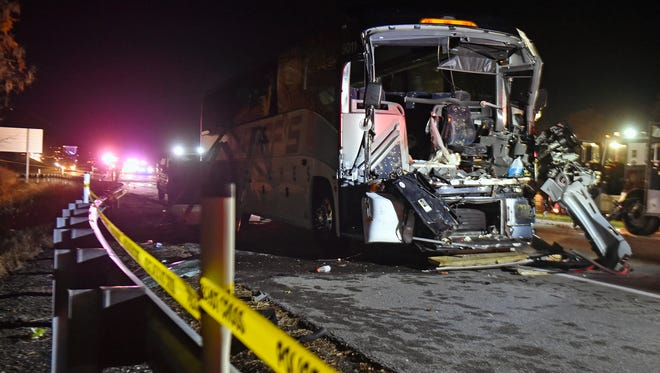 The remains of a charter bus that had carried the Eastern York High School football team sit in the eastbound lanes of Rt. 30 after a head-on crash with an SUV on Oct. 28, 2017. Emergency responders had to cut away the front of the bus to extricate its driver after the crash. Students climbed out through windows with help from firefighters. The SUV driver died in the crash.