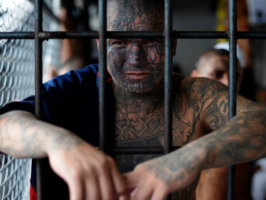 A member of Mara Salvatrucha gang poses