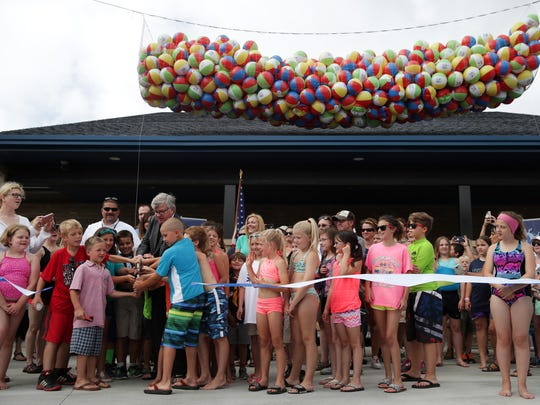 Appleton Mayor Tim Hanna cuts the ribbon for the Erb Park Pool with community members during pool's grand opening  Wednesday, July 12, 2017, in Appleton, Wis.Danny Damiani/USA TODAY NETWORK-Wisconsin