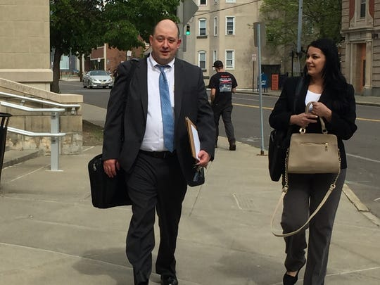 Defense lawyer Ben Bergman leaves the courthouse after jurors declared a deadlock in Jason Stokes' arson trial on Friday, May 12, 2017.