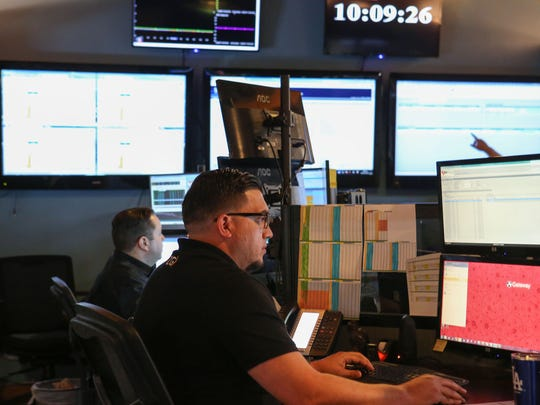 ZGlobal employees Oscar Aguilar, right, and Francisco Garcia schedule energy transactions from the company's control room in El Centro, California, on June 29, 2017.
