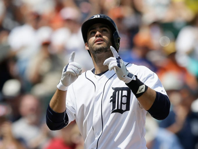 Detroit Tigers' J.D. Martinez looks skyward after his