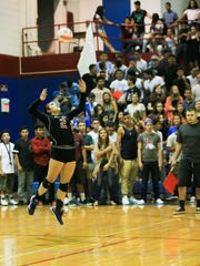Las Cruces High School libero Givy Padilla serves the ball against El Paso Franklin High School on Tuesday at LCHS.