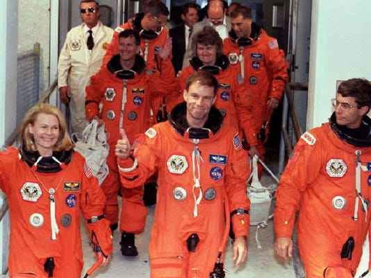 The crew of the shuttle Discovery leave the Operat