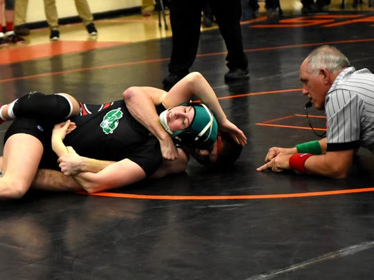 Andrea Schlabach of Badin grapples hard in first round