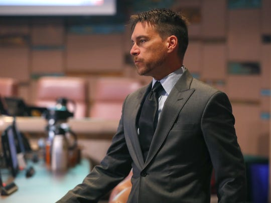 Tempe Councilman Kolby Granville walks before the start of the Tempe City Council meeting at the Tempe Municipal Building on Feb. 8, 2018, in Tempe.