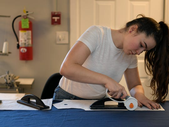 O'More College of Design junior Kelly Nieser cuts fabric
