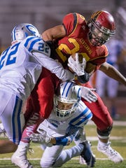 Centennial running back Josiah Leon barrels through