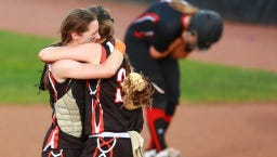 Kaukauna pitcher Haley Hestekin (right) gives catcher Michaela Meehl a big hug after the Galloping Ghosts beat Wilmot, 3-1, in the WIAA Division 1 title game in softball on Saturday in Madison.