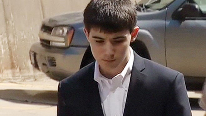 This Jan. 4, 2013, photo from video provided by KDLT-TV shows Braiden McCahren outside court in Pierre.