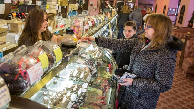 Customers check out the selection at Govatos Chocolates on Market Street in Wilmington.