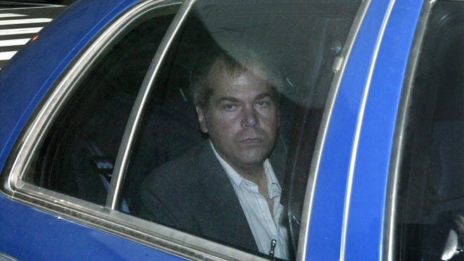John W. Hinckley Jr., who tried to kill President Ronald Reagan, arrives at U.S. District Court in Washington in 2003.