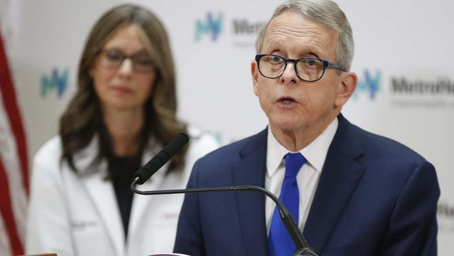Gov. Mike DeWine and Ohio Health Director Dr. Amy Acton speak during a coronavirus press conference. Policy experts say the economic downturn might create great numbers of uninsured Ohioans in the face of the pandemic unless quick policy measures are taken.