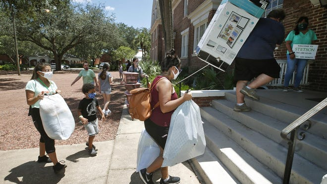 With the help of family and friends, new Stetson students move into the dorms on campus in DeLand on Saturday, Aug. 8, 2020. In the wake of the coronavirus pandemic, students had to take part in a screening process before entering campus.