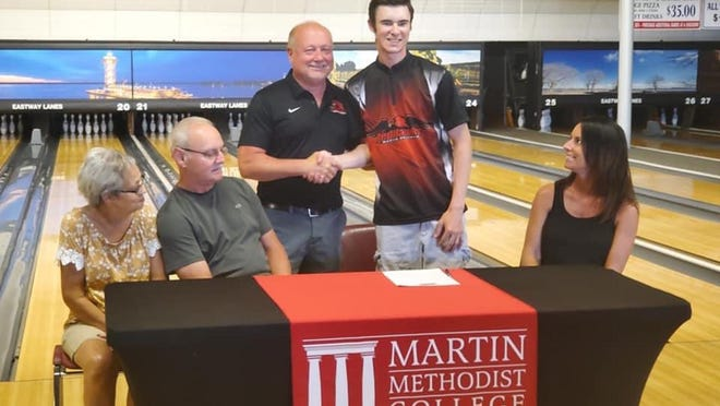 Erie resident Hayden Stippich, standing right, shakes hands with Erie bowling great Bob Learn Jr.  at Eastway Lanes after committing to attend Martin Methodist College in Tennessee and compete for Learn's bowling team.