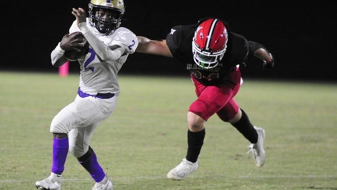 Rashad Williams of ARC, left, looks for running room as he is pursued by Harlem's Jake Burch at the high school football game between ARC and Harlem on October. 9, 2020 in Harlem, Ga.