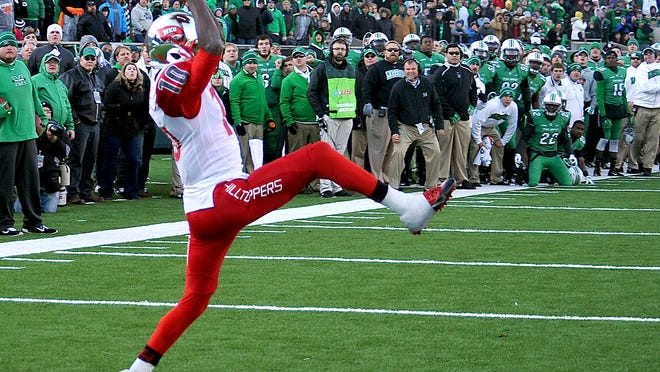 Western Kentucky's Willie McNeal (10) makes the game-winning catch in overtime for the two point conversion in an NCAA college football game against Marshall University in Huntington, W.Va., Friday, Nov. 28, 2014. (AP Photo/Chris Tilley)