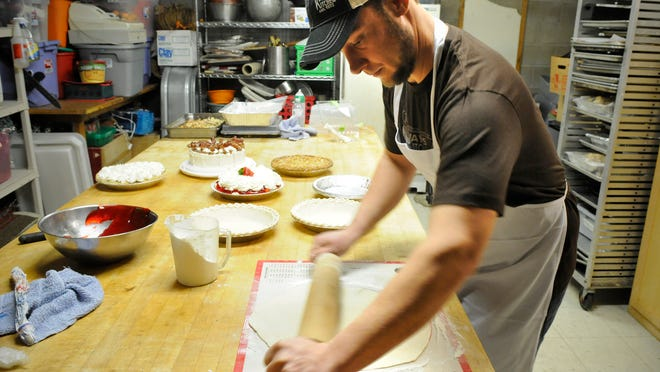 Baker Dan Kuebelbeck rolls out a homemade pie crust at Kay's Kitchen in St. Joseph on Dec. 17.