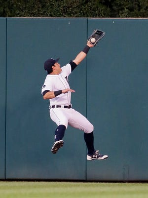 Tigers centerfielder Mikie Mahtook makes a leaping catch of a ball hit by Royals catcher Salvador Perez for the third out of the fifth inning of the Tigers' 5-3 win Tuesday at Comerica Park.