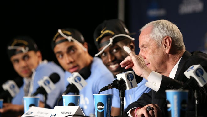 North Carolina Tar Heels head coach Roy Williams shows his cut that occurred when cutting down the net during a press conference after defeating the Notre Dame Fighting Irish in the championship game in the East regional of the NCAA tournament at Wells Fargo Center. North Carolina won 88-74.