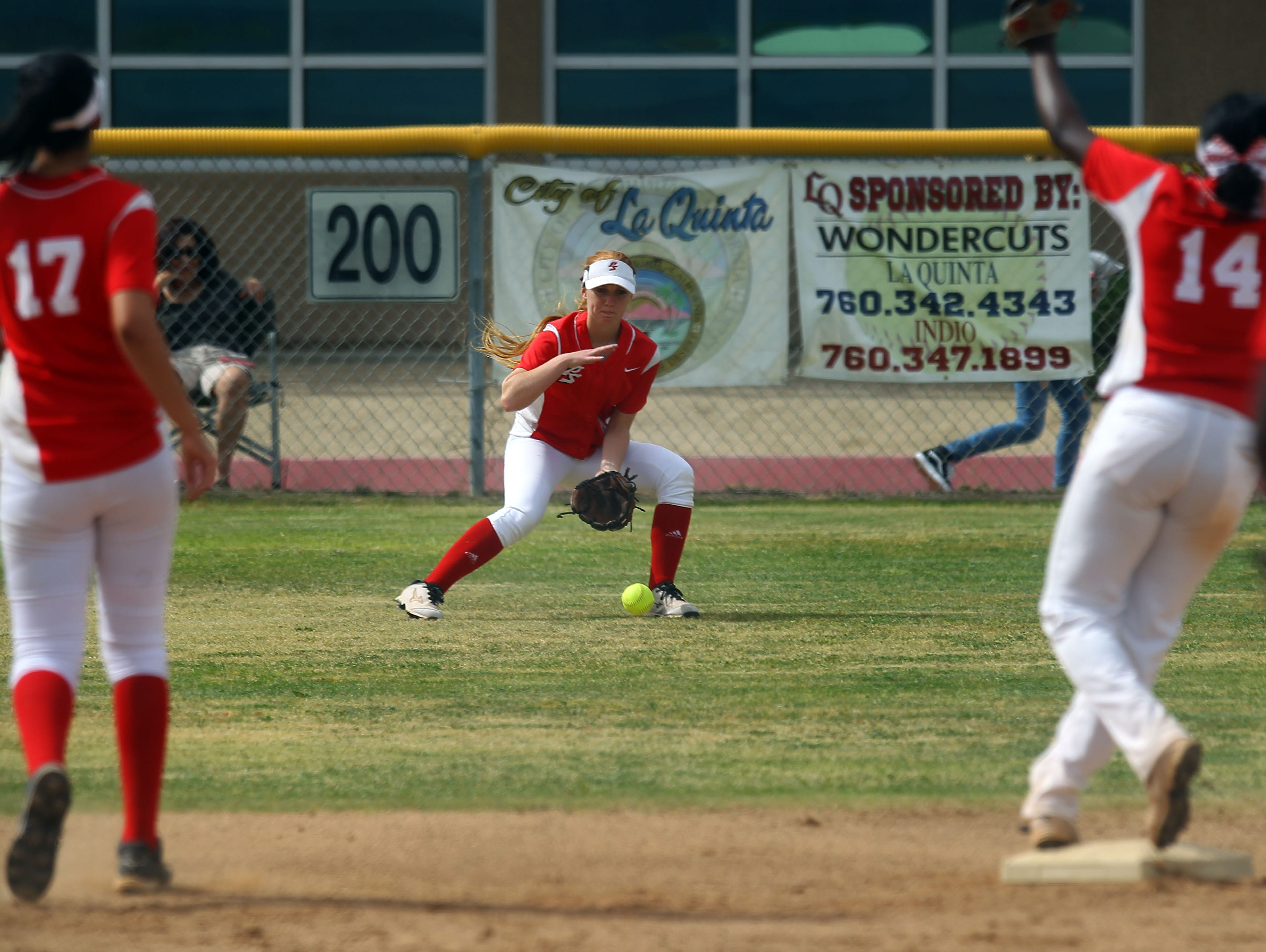 Palm Springs' Raquel Harris stops a La Quinta ball to center field in the 2nd inning on Friday, May 6, 2016 at La Quinta High School.