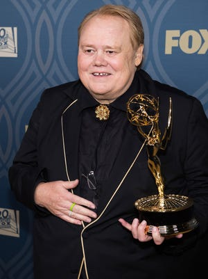 Louie Anderson holds his Emmy Award on Sept. 18 in Los Angeles.
