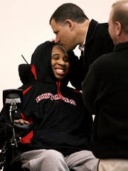 Eric LeGrand and his former college football coach,