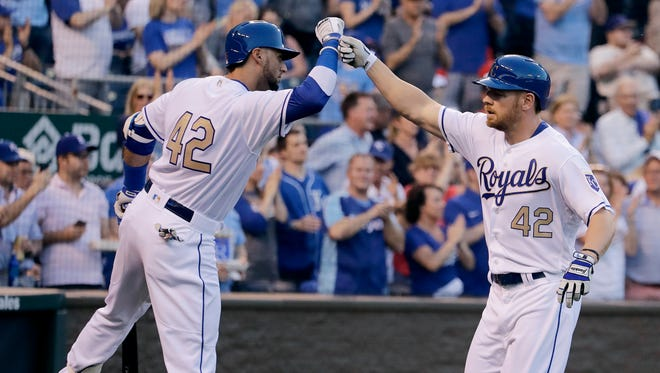 Kansas City Royals' Brandon Moss, right, celebrates with Paulo Orlando after hitting a solo home run during the fourth inning of a baseball game against the Los Angeles Angels, Saturday, April 15, 2017, in Kansas City, Mo.