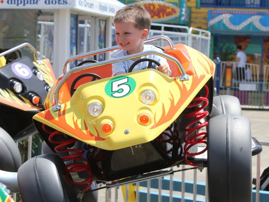 Johnny Molte, 3 of Marlboro rides kiddie ride on the Casino Pier in Seaside on Memorial Day. Monday May , 26, 2014, Seaside Photo by Robert Ward