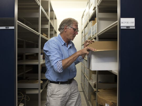 "Chris Baisan checks a box containing Prometheus cross sections, Aug. 7, 2015, in the archive at the Laboratory of Tree-Ring Research, University of Arizona, Tucson. At the tree-ring lab, researchers tell a more scientific version of the story. They don't talk much about Prometheus and, although the three boxes are marked ""Currey Tree,"" for Donald Currey, the graduate student who cut the bristlecone down, the preferred name is its specimen reference, WPN-114."