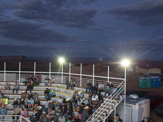 Spectators find seats at Ken's Arena near Antelope Point in Page, where 40 bull riders will compete in the 15th Annual Kenny Young Bull Riding Classic.