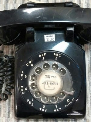 It only takes fifteen seconds to dial a local number on this thing.