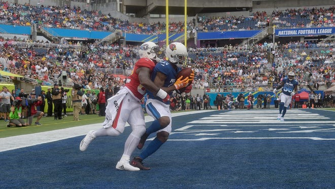 NFC cornerback Patrick Peterson (21), of the Arizona Cardinals, intercepts a pass in the end zone as, AFC tight end Delanie Walker (82), of the Tennessee Titans, defends, during the first half of the NFL Pro Bowl football game, Sunday, Jan. 28, 2018, in Orlando, Fla. (AP Photo/Phelan M. Ebenhack)