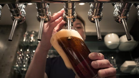 The owner of a Howell area gravel pit and concrete company has a plan to build a microbrewery and neighborhood hang out on his Mason Road property. A stock image shows an individual pouring craft beer.