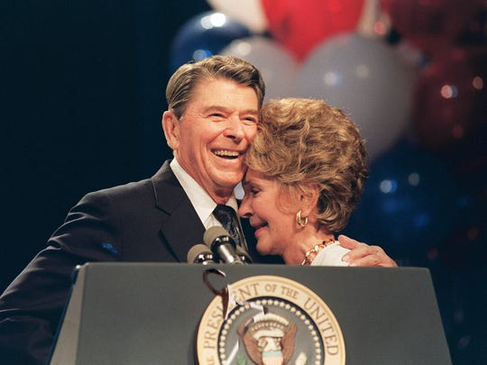 This file photo taken on August 15, 1988, shows First Lady Nancy Reagan and her husband, President Ronald Reagan, at a luncheon in New Orleans honoring her for her work to combat drug abuse.