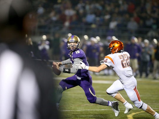 North Kitsap quarterback Andrew Blackmore (15) had a pair of older brothers, Cody and Jordyn, who played the position for the Vikings.