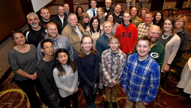 Students, parents and teachers celebrate essay winners from Oshkosh Area School District middle schools. Pictured in front are essay winners Chase Pecore, Ethan Ruedinger, Paige Helfrich, Malina Lor and Ryan Gohde.