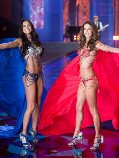 Adriana Lima, left, and Alessandra Ambrosio present