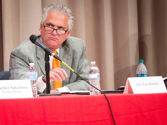Distressed Unit Appeals Board member Eric Bassler listens