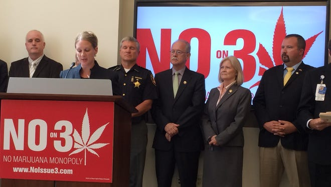 Pharmacist Patricia Klein, second from left, and other local officials speak at a news conference Monday at Cincinnati Children's Hospital Medical Center against passage of Issue 3, the initiative that would legalize marijuana in Ohio. The event was organized by the political group No on 3.