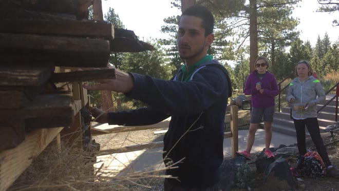 Elrick du Saillant du Luc, 23, a student at Aix Marseille University, shows Reno-area elementary students the 'bee hotel' at Galena Creek Visitor Center. He helped create the project as part of his zoology studies.