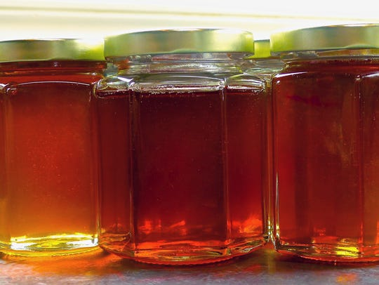 This Sept. 20, 2015 photo shows jars of raw honey in
