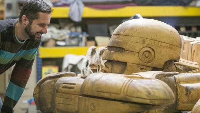In 2014, Brandon Walley, development director for Imagination Station, checks out the progress of building the RoboCop statue at Venus Bronze Works.