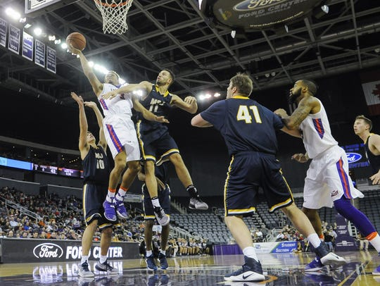 University of Evansville guard Jaylon Brown goes to