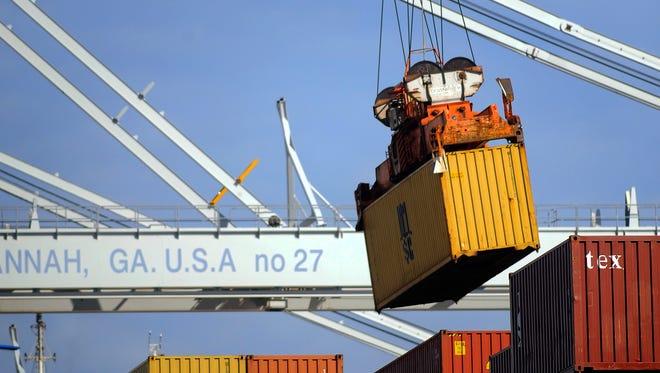 A ship to shore crane unloads a shipping container at the Georgia Ports Authority Garden City terminal, in Savannah, Ga.