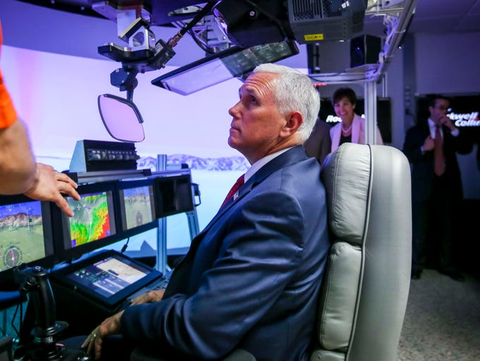 Vice President Mike Pence is given a tour of a flight