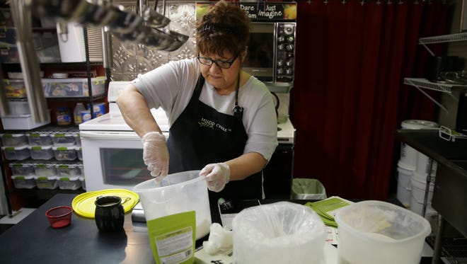Donna Klausen, owner of Mudd Creek, packages her gluten-free waffle/pancake mix in the state-licensed kitchen at her home in Grand Chute.