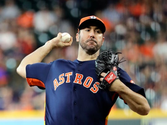 Astros pitcher Justin Verlander throws against the