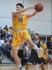 LSUA's Gilbert Talbot (15) goes for two against Our